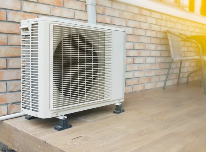 what does an ac condenser do